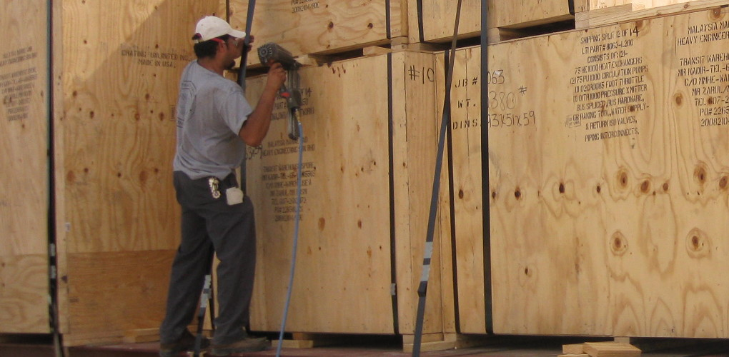 CCI Employee crating up a container with nailgun
